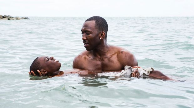 Alex Hibbert (foreground), and Mahershala Ali in <i>Moonlight</i>.