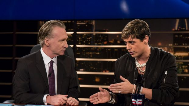 """Bill Maher, left, listens to Milo Yiannopoulos, a writer for Breitbart News, on HBO's """"Real Time with Bill Maher"""""""
