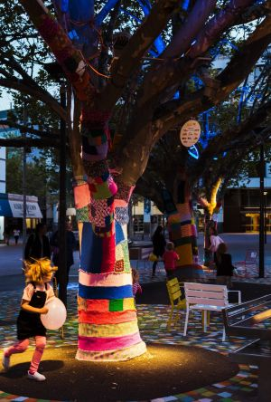 Part of the installation saw the bases of trees be covered by knitting.