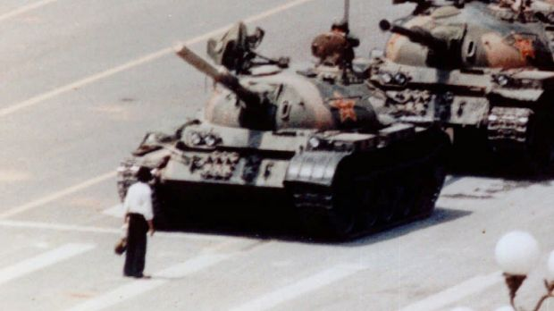 An anti-government protester stands in front of artillery tanks in Beijing's Tiananmen Square in 1989. The spirit of ...