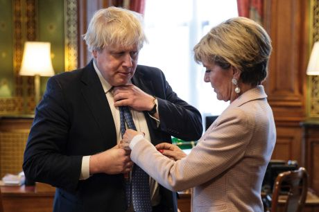 British Foreign Secretary Boris Johnson has his tie straightened by his Australian counterpart Foreign Minister Julie Bishop.