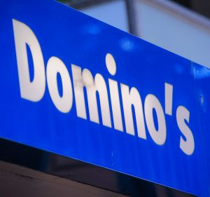 Domino's may have to share more profit with franchisees, which would crimp profit growth.