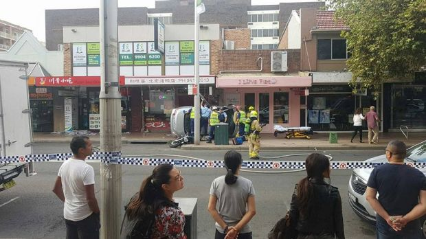 Witnesses said the car mounted a footpath and struck a woman in Chatswood.