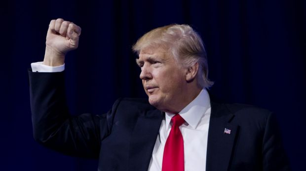 US President Donald Trump gestures on stage during the Conservative Political Action Conference (CPAC) on Friday.