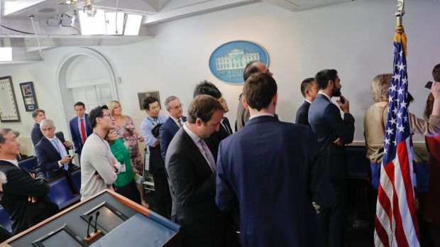 Reporters line up hoping to enter a briefing in US press secretary Sean Spicer's office at the White House on Friday.