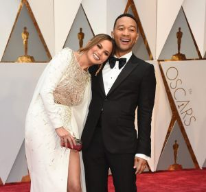 Chrissy Teigen,and John Legend arrive at the Oscars this year.