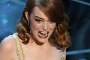 Emma Stone accepts the Oscar for best actress for <i>La La Land</i>.