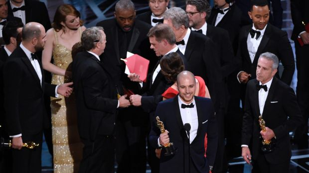 Fred Berger, producer of La La Land, foreground centre, gives his acceptance speech as members of ...
