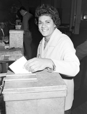 An Indigenous woman casts her vote during the 1967 referendum at polling booth at Sydney Town Hall.