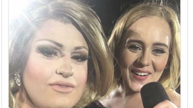 Adele impersonator feminem on stage with the real Adele at Domain Stadium.