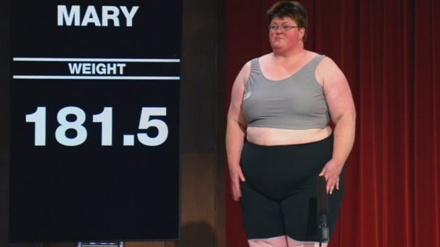 Contestant Mary, from the 2014 season, strips down for her first weigh-in.