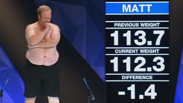 Contestant Matt, from the 2014 season of <i>The Biggest Loser</i>, next to the giant screen used in studio weigh-ins.