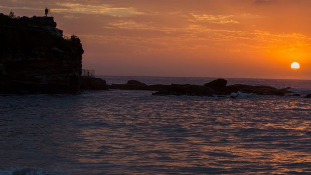 Dawn at Coogee on February 12, another day of record temperatures and the threat of bushfires amid catastrophic weather ...