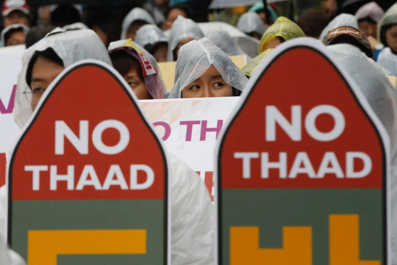 South Korean protesters attend a rally in Seoul to oppose a deployment of THAAD, last July.