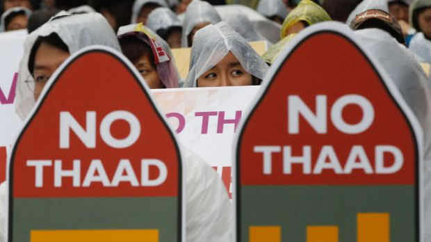 South Korean protesters attend a rally in Seoul to oppose a deployment of THAAD last July.