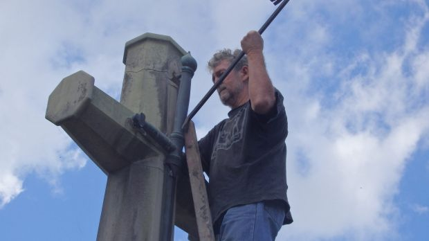 Photos of the Catholic Worker movement members vandalising the Cross of Sacrifice on Ash Wednesday were emailed to Fairfax.