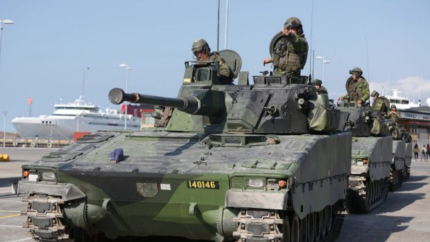Swedish armoured personnel carriers in Visby harbour on the island of Gotland, Sweden.