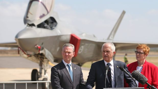 Defence Industry Minister Christopher Pyne, Prime Minister Malcolm Turnbull, and Defence Minister Marise Payne speak to ...