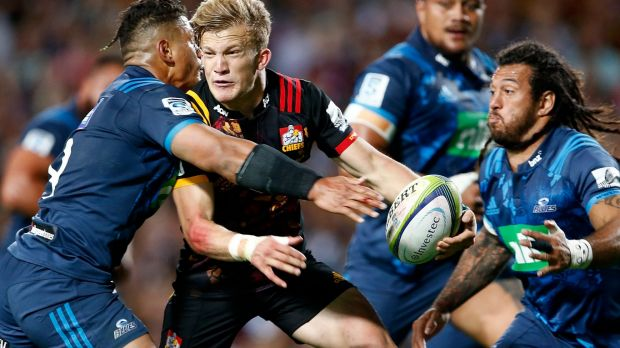 Speed to burn: Damian McKenzie enters the fray at Rugby Park in Hamilton.