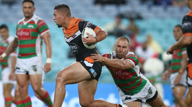 Midfield break: Josh Aloiai bends the South Sydney line.