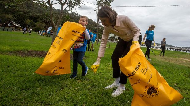 NSW Premier Gladys Berejiklian, pictured on Clean Up Australia Day in 2017, has been urged to ban plastic bags.