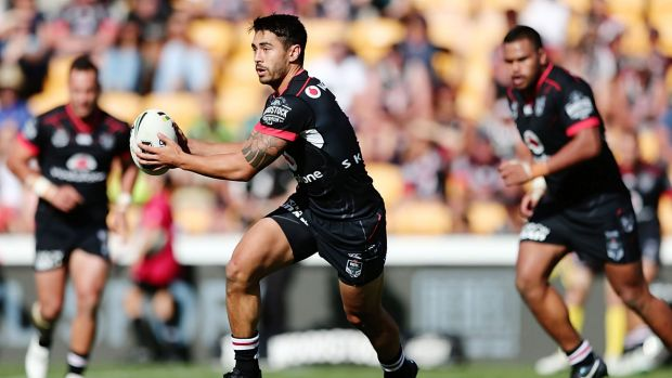 Playmaker: Shaun Johnson on the run for the Warriors.