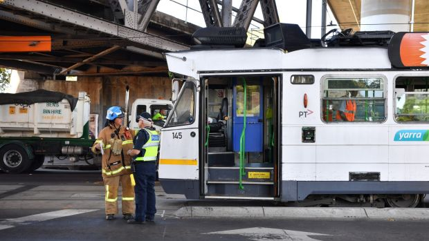 Trams on Racecourse Road are being diverted after the truck collided with the bridge.