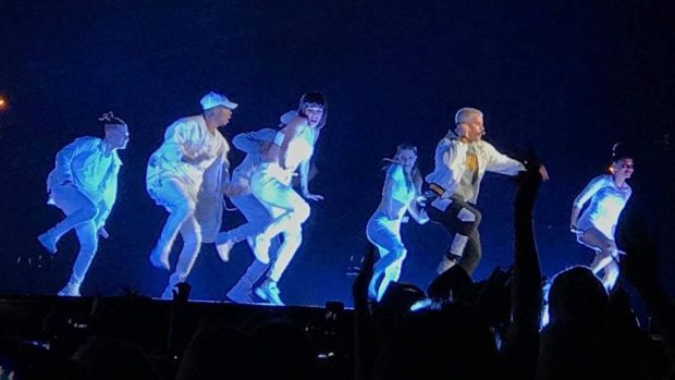 Justin Bieber flanked by 20 backup dancers.