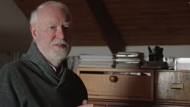 David Stratton in his home office in a scene from the film. As a young man he rebelled against his upbringing, refusing ...