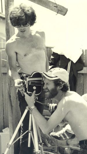 Louis Irving behind the camera, with David Brostoff (standing) on the set of <i>Newsfront</i> in 1977.