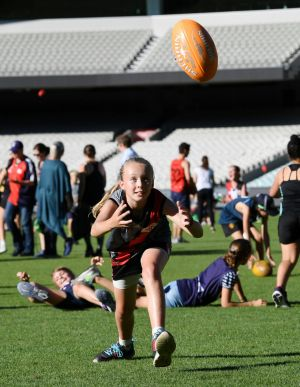 Ella Russell takes a mark at the MCG.