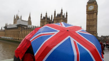 Tourists shelter from the rain under a Union Jack umbrella near the Houses of Parliament. Brexiters who insist on ...