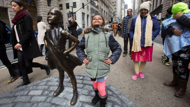 "Strike a pose: Shriya Gupta, a girl from Cherokee, North Carolina, is having her picture taken with the ""Fearless Girl""."