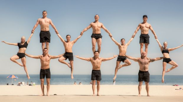 Members of Cirque du Soleil at Port Melbourne Beach.