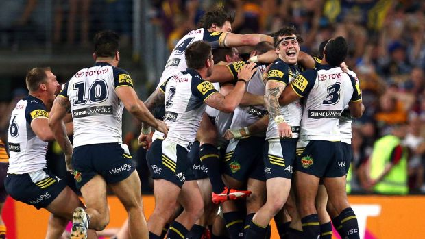 Greatest game of all: Cowboys players celebrate after Johnathan Thurston kicked the winning field goal in golden point ...