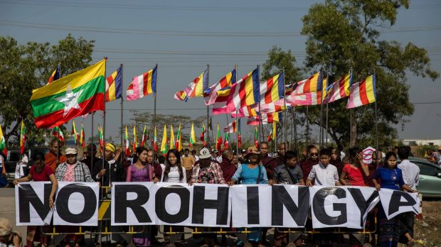 """Buddhist chauvinists belonging to the extremist Ma Ba Tha movement protest the use of the word """"Rohingya"""" as a donation ..."""