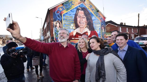 Sinn Fein president Gerry Adams takes a selfie with southern leader Mary Lou McDonald, centre, and northern leader ...