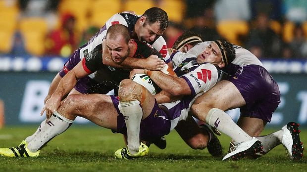 Tangle of bodies: Simon Mannering is tackled by Smith and Dale Finucane.