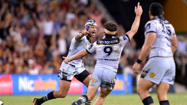Golden moment: Johnathan Thurston wheels away in celebration after kicking the winning field goal.