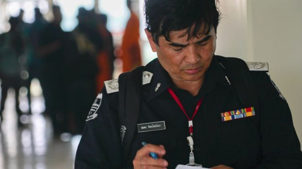 An officer checks his notes inside a medical centre on the Wat Dhammakaya temple compound in Pathum Thani province, Thailand.