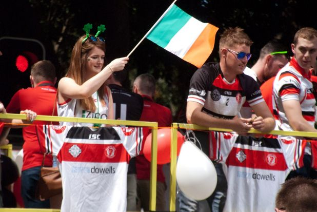 Onlookers lined the streets as a sea of green spilled into the streets and into Brisbane's Irish bars.