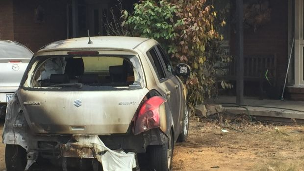 The remains of the car after it was set on fire during a targeted attack on an Isabella Plains home.