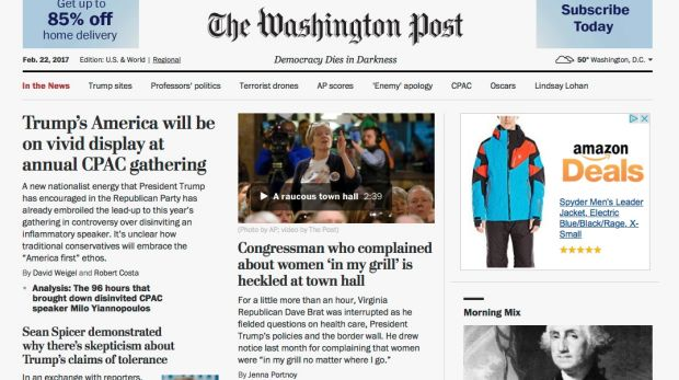 "<i>The Washington Post</i>  website with its new motto, ""Democracy Dies in Darkness""."