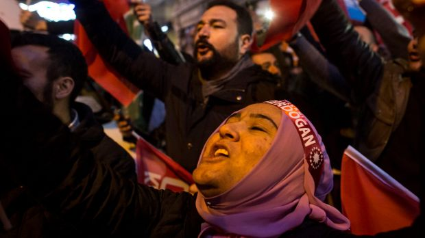 Protesters sing and chant outside the Dutch consulate in Istanbul after Turkey's foreign minister was turned away from ...