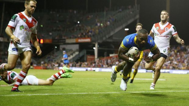 Headline act: Semi Radradra scores against the Dragons.