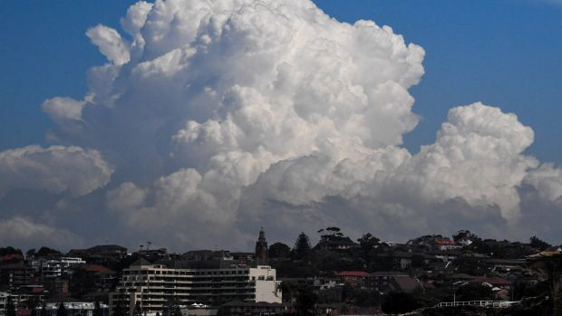 Clouds build over Sydney on Monday as parts of NSW are on a severe weather warning.