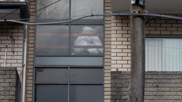 Forensic officers combed the top-floor apartment on Monday afternoon.