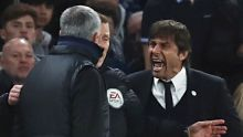 LONDON, ENGLAND - MARCH 13:  Fourth official Mike Jones intervenes as Jose Mourinho manager of Manchester United and ...