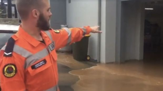 Water floods a property in Penrith after heavy rains from a storm system moving across NSW.
