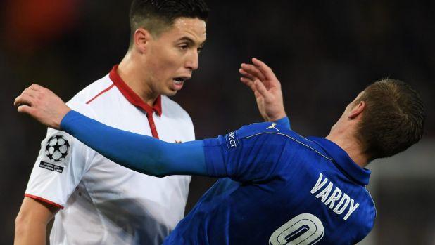 Shocked: Samir Nasri of Sevilla and Jamie Vardy of Leicester City clash.
